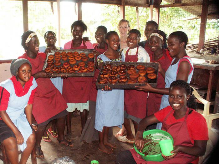 The girls showing off what they have produced in the baking class.